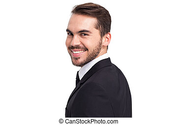 Elegant businessman in suit smiling at camera
