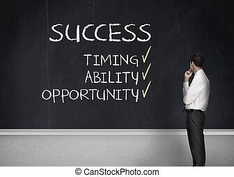 Elegant businessman looking at success terms