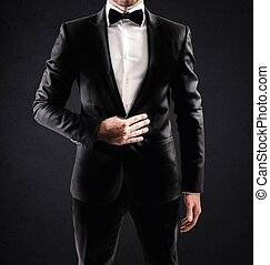 Elegant businessman - Sexy elegant businessman with bow tie...