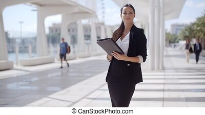 Elegant businesswoman on a seafront promenade