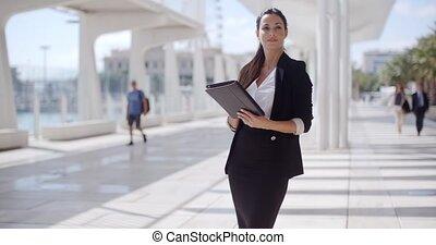 Elegant businesswoman on a seafront promenade - Elegant...