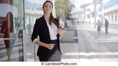 Elegant businesswoman standing waiting
