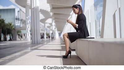 Elegant businesswoman talking on her mobile