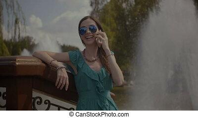 Elegant carefree woman enjoying summer vacations