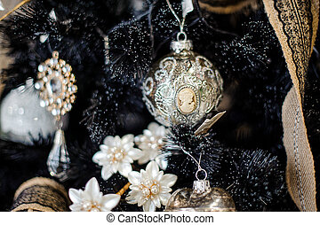 Elegant Christmas tree decoration toy in the form of a ball with woman portrait