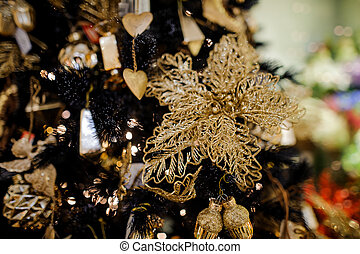 Elegant Christmas tree decoration toy in the form of a golden flower