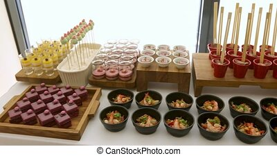 Elegant colourful dessert buffet with various sweets -...