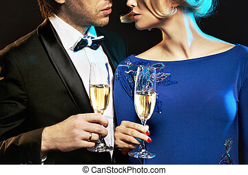 Elegant couple drinking a champagne