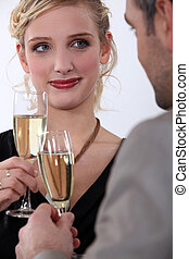 Elegant couple drinking champagne