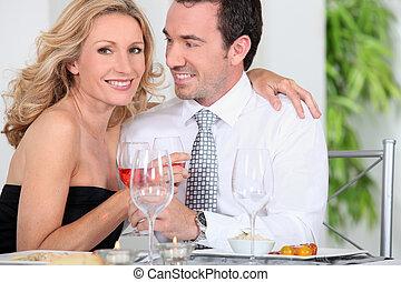 Elegant couple drinking wine
