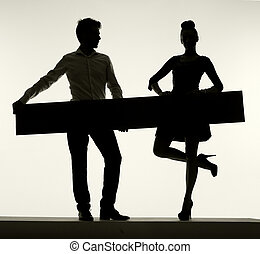 Elegant couple holding the empty board