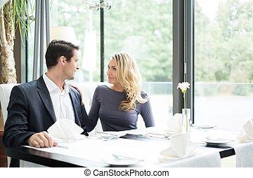 Elegant couple in a restaurant