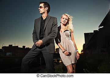 Elegant couple over a sunset background