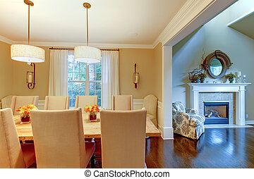 Elegant cream natural dining room with fireplace.