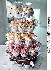 Elegant cupcakes exposed in a confectionery - Elegant ...