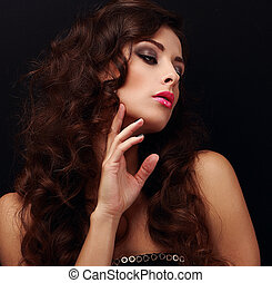 Elegant curly hair woman looking. Bright model with smokey...