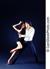 elegant dance - Beautiful couple of professional artists...
