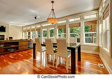 Elegant dining table set in spacious living room