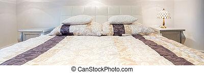 Elegant double bed in bedroom