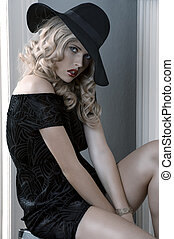 elegant dressed girl posing with a hat