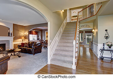 elegant entry way with stairs, and arched door way.