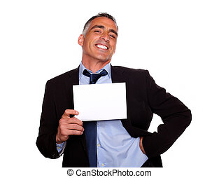Elegant executive man smiling with a white card