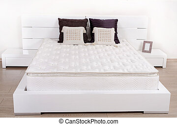 Elegant fancy white bedroom with double bed