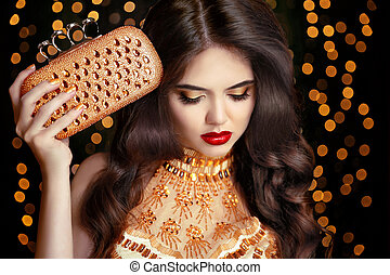 Elegant fashion brunette woman in gold