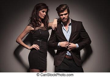 elegant fashion couple on dark grey background - Picture of ...
