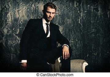 elegant fashion for men - Portrait of a handsome man in an...