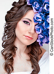 Elegant, fashionable, glamorous and good-looking girl, model with blue wreath. Beautiful, fashionable, glamour, attractive, elegant, sensual girl, woman, princess, lady with blue, flower, wreath, fantasy portrait, art, crown, white, bright face, skin, glamour, creative.
