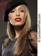elegant fashionable woman in a hat
