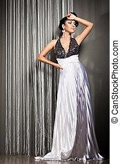 elegant fashionable woman in beautiful dress