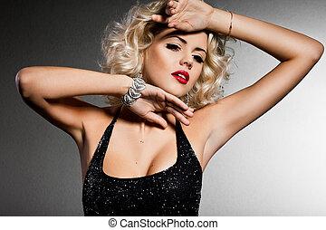 elegant fashionable woman in black dress