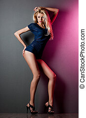 elegant fashionable woman in blue dress