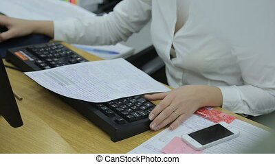 Elegant female hands types on a black computer keyboard....