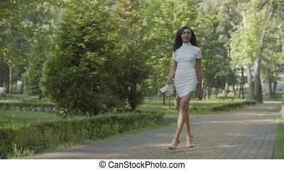Elegant female in stiletto shoes strolling outdoor - Slim ...