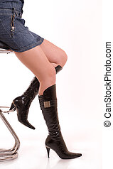 Elegant female legs in leather boots