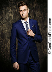 elegant formal suit - Fashion shot of a handsome young man...