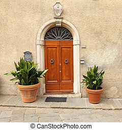 elegant front door to the tuscan house