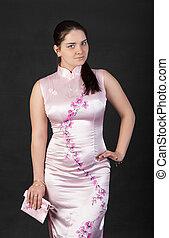 elegant girl in a pink dress