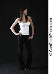 Elegant girl in white top, black background