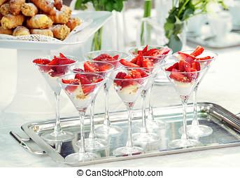 Elegant glasses of strawberry dessert on a buffet