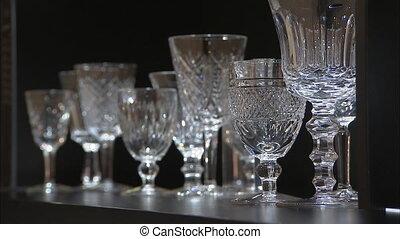 Elegant glassware's on black shelf - A steady shot of...