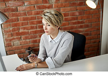 elegant gorgeous good looking fair-haired businesswoman in fron of the screen