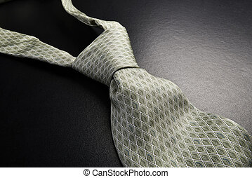 Elegant gray tie on a black background in the style fifty ...
