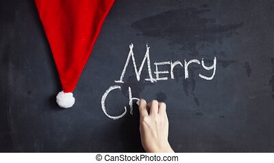 Elegant greeting card design decorated with snowflakes on chalkboard background for Merry Christmas celebration.