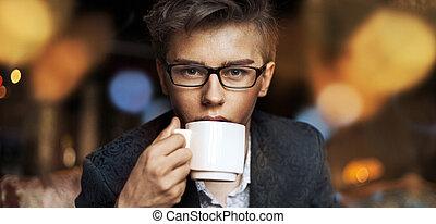 Elegant guy drinking a coffee