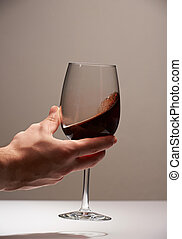 Elegant hand with red wine glass