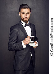 Elegant handsome man drinking coffee - Elegant handsome guy...